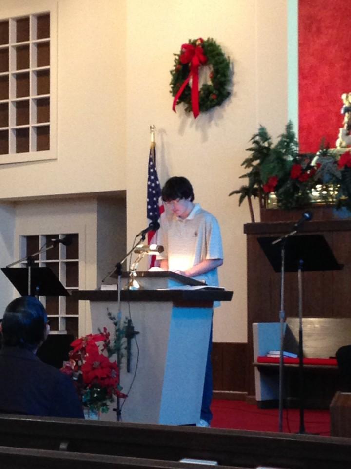 Sam Reading Scripture at Christmas Service